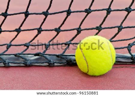 tennis ball and tennis net