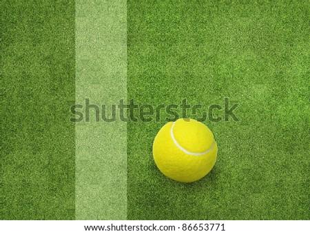 tennis ball beside the court line.