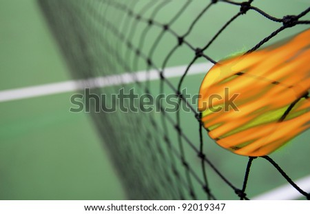 Tennis ball burning in net