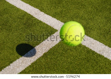 Tennis ball close to the service line