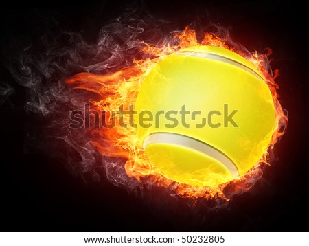 Tennis ball enveloped in fire flames isolated on black background.