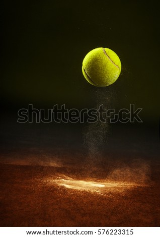 Tennis ball falling on the ground.