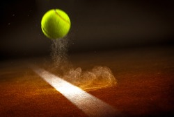 Tennis ball falling on the line.