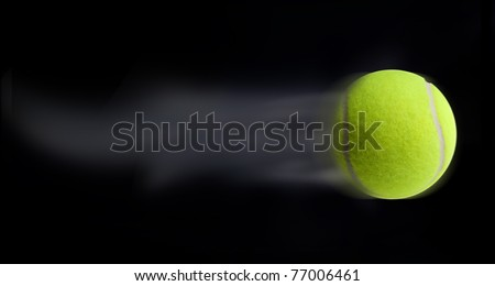 Tennis ball fast moving on black background leaving trail behind #77006461