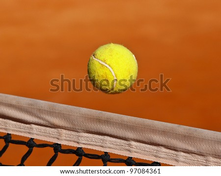 tennis ball fly over the net