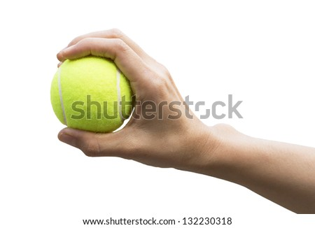 Tennis ball in hand on white background (with clipping path)