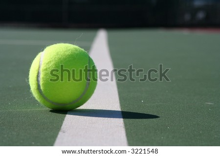 Tennis ball just inside the line