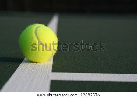 Tennis ball near the midcourt line