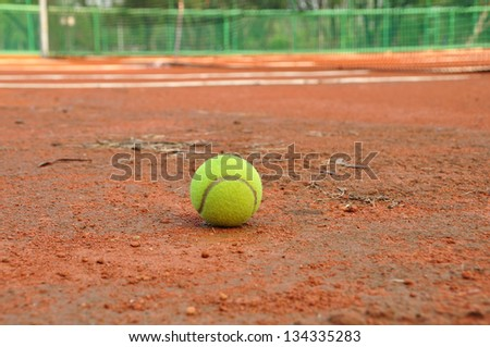 Tennis ball on a tennis clay court