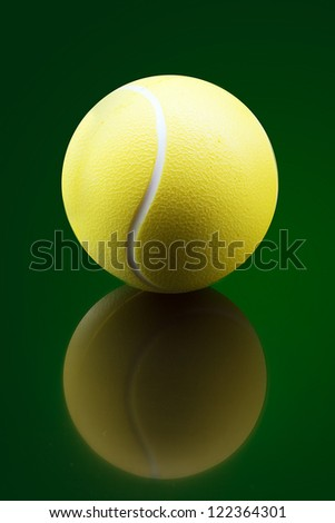 Tennis ball on green background