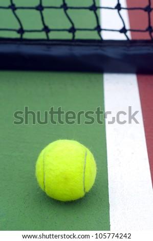 tennis  ball on line green court