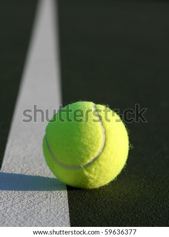 Tennis Ball on the Court along the line