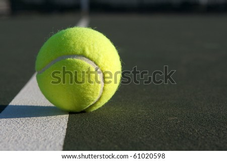 Tennis Ball on the Court Line with room for copy