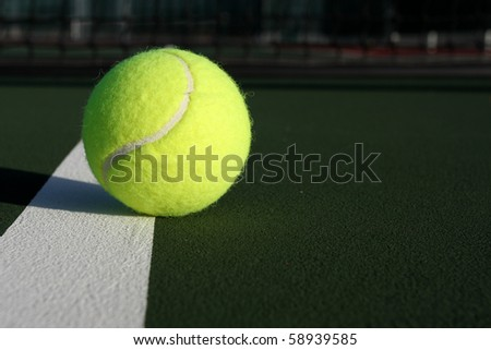 Tennis Ball on the Court with net in background