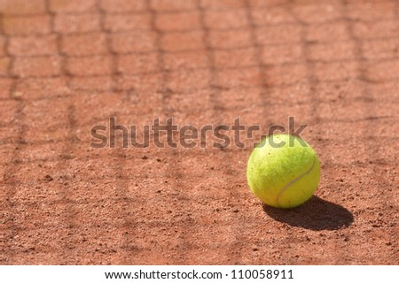 Tennis ball on the floor in a clay court