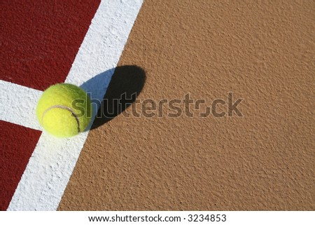 Tennis ball on the line of a new tennis court