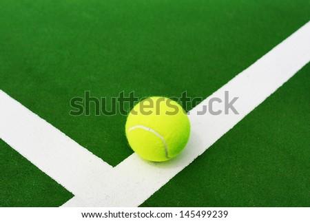 stock-photo-tennis-ball-on-white-line-of-hard-court-145499239.jpg