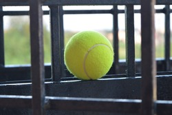 Tennis ball placed in iron grills