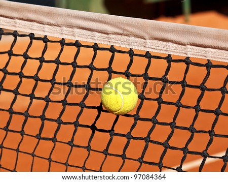 tennis ball stack in the net