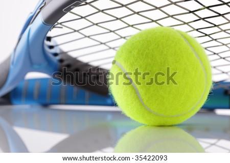 Tennis ball under the strings of a tennis racket