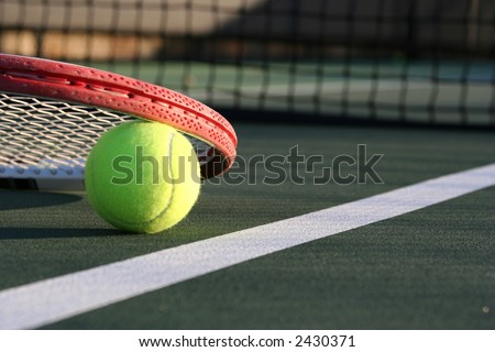 Tennis ball with a detailed racket