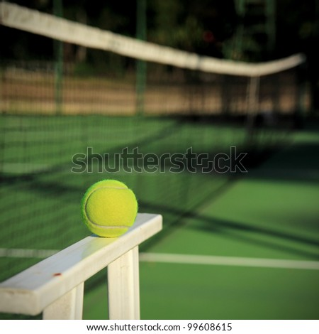 Tennis ball with net background