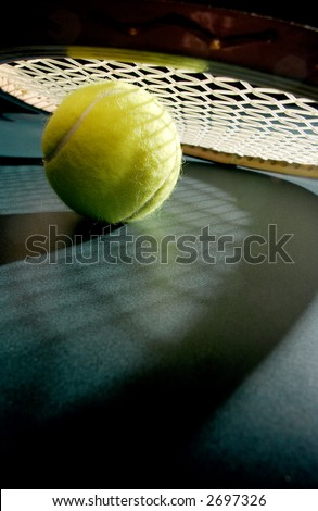 Tennis ball with racket & shadows