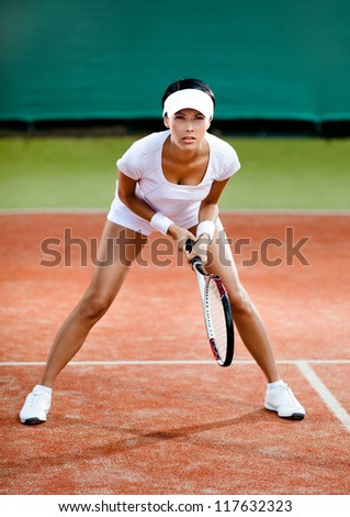 Tennis competition. Female player at the clay tennis court