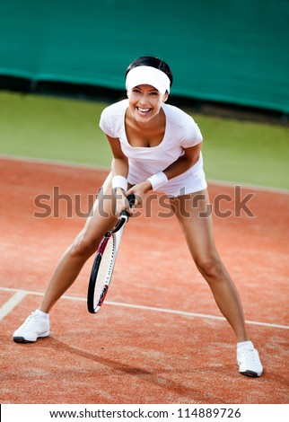 Tennis contest. Female player at the clay tennis court