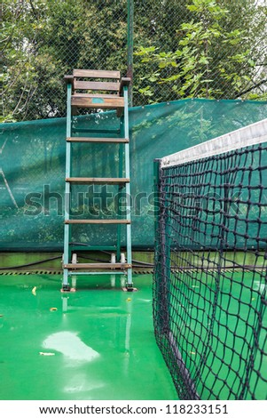 tennis court after rain, with wet floor - stock photo