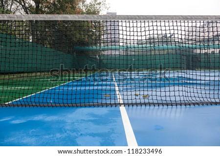 tennis court after rain, with wet floor