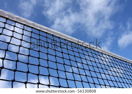 Tennis Court Net amongst Cloudy Sky