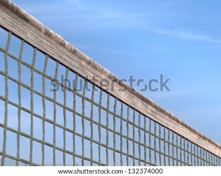 tennis court net and sky 76