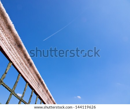 tennis court net and sky 133