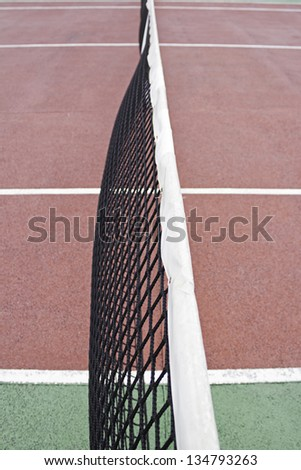 Tennis court with red floor fitness center, sport and fun