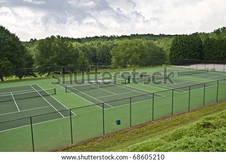 Tennis courts that have been abandoned because of rainy weather.