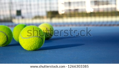 Tennis game. Tennis balls on the tennis court. Sport, recreation concept