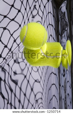 Tennis net and yellow ball with warped reflections