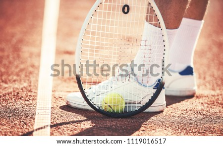 Tennis player, close up photo. Man playing tennis. Sport, recreation concept Foto stock ©