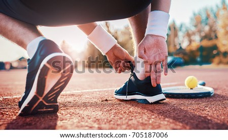 Tennis. Player is getting ready for the match. Sport, recreation concept Foto stock ©