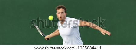 Tennis player man banner hitting ball with racket on green horizontal copy space background. Sports athlete training forehand grip technique on outdoor court.