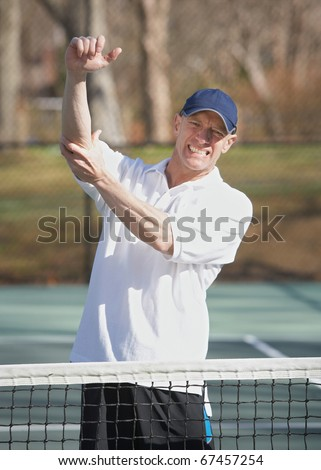 Tennis player man in pain with elbow injury