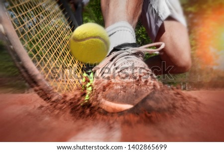 Tennis player on clay tennis court