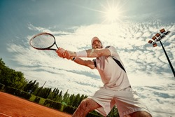 Tennis player playing tennis in nature