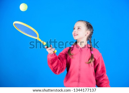 Tennis player with racket and ball. Little teen girl. Fitness diet brings health and energy. Happy child teen girl play tennis. Sport game success. Gym workout of teen girl. teen girl practice skills. #1344177137