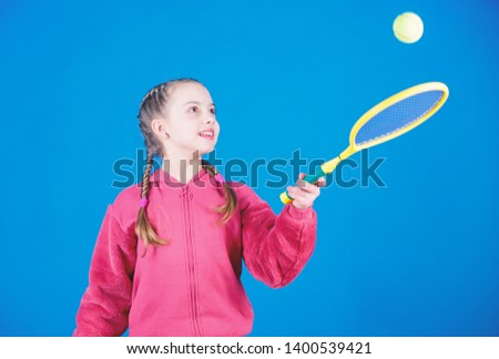 Tennis player with racket and ball. Little teen girl. Fitness diet brings health and energy. Happy child teen girl play tennis. Sport game success. Gym workout of teen girl. teen girl practice skills. #1400539421