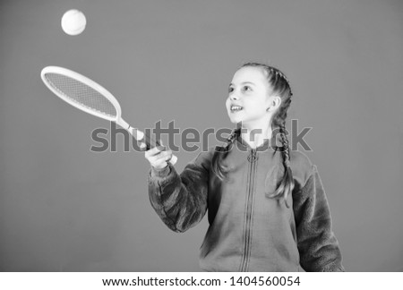 Tennis player with racket and ball. Little teen girl. Fitness diet brings health and energy. Happy child teen girl play tennis. Sport game success. Gym workout of teen girl. teen girl practice skills. #1404560054