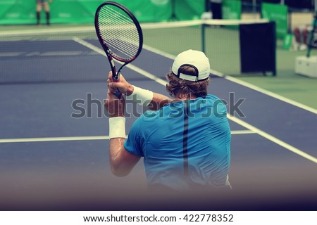 Tennis players playing a match and blurred background, vintage tone