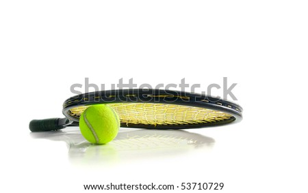 Tennis racket and ball on white surface