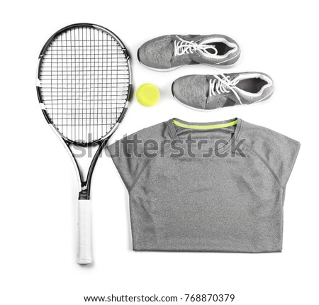 Tennis racket, ball, clothes and shoes on white background